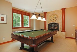 Eclectic Game Room with Fireplace, Standard height, Pendant light, Casement, insert fireplace, Concrete floors