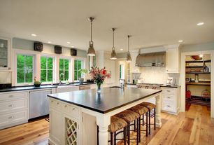 Traditional Kitchen with Reclamation plank natural oak handscraped solid hardwood, Flat panel cabinets, Breakfast bar