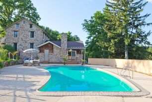 Rustic Swimming Pool with French doors, exterior stone floors, Fence