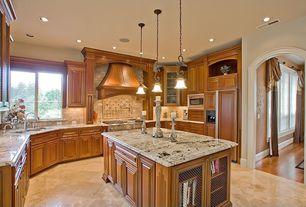 Traditional Kitchen with Custom hood, double oven range, Kichler lighting wilton mini pendant, Kitchen island, Concrete tile
