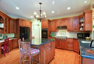 Traditional Kitchen with Stone Tile, Livex Lighting Villa Verona Bronze Three-Light Chandelier, Hardwood floors, Glass panel