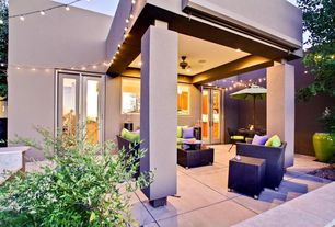 Contemporary Porch with exterior tile floors, French doors, Wrap around porch