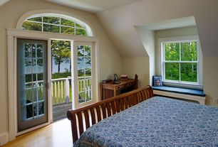 Craftsman Guest Bedroom with Arched window, Standard height, Laminate floors, double-hung window, Glass panel door