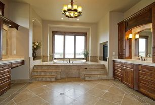 Traditional Master Bathroom with can lights, stone tile floors, Undermount sink, drop in bathtub, Framed Partial Panel