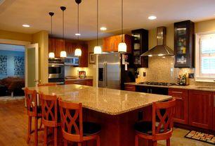 Craftsman Kitchen with Breakfast bar, full backsplash, Flush, Hardwood floors, can lights, double wall oven, L-shaped