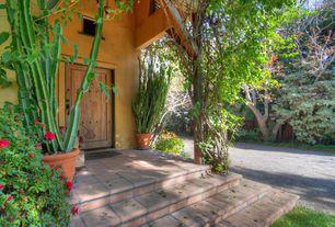 Rustic Front Door with Fence, exterior brick floors