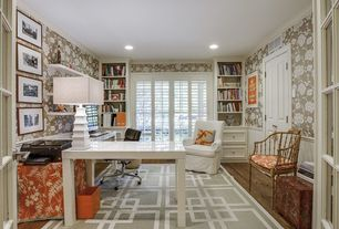 Traditional Home Office with Built-in bookshelf, Crown molding, interior wallpaper, Hardwood floors, French doors