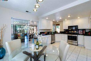 Contemporary Kitchen with flush light, limestone tile floors, Raised panel, Soapstone, Pendant light, U-shaped