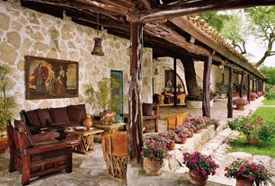 Eclectic Porch with Raised beds, French doors, Wrap around porch, Pathway, Gate