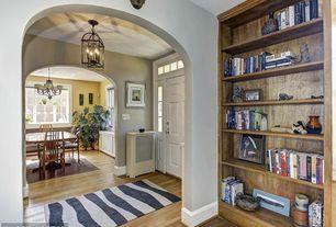 Entryway with Hardwood floors, Chandelier, Transom window
