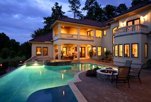Mediterranean Patio with Fire pit, Infinity pool, exterior brick floors, Casement, sliding glass door, Pool with hot tub