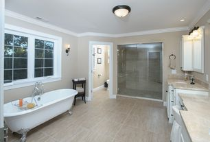 Traditional Master Bathroom with Standard height, Crown molding, Bathtub, stone tile floors, partial backsplash, Wall sconce