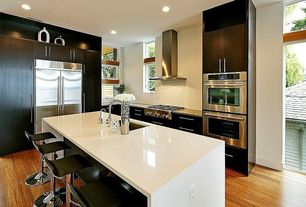 Contemporary Kitchen with Corian counters, Daltile Color Wave Whipped Cream Straight Joint Mosaic, Flush, Undermount sink