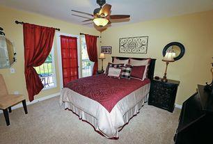 Mediterranean Guest Bedroom with Ceiling fan, French doors, picture window, Built-in bookshelf, Carpet, Standard height