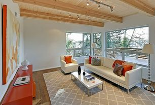 Modern Living Room with can lights, Exposed beam, Casement, picture window, Hardwood floors, Standard height