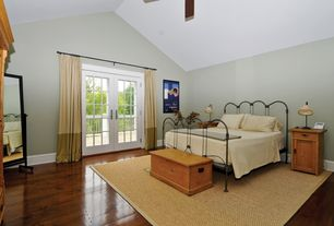 Traditional Master Bedroom with French doors, Ceiling fan, Hardwood floors, High ceiling