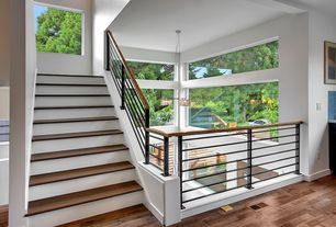 Contemporary Staircase with picture window, High ceiling, curved staircase, Hardwood floors