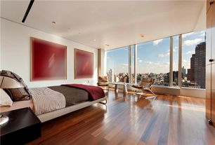 Contemporary Guest Bedroom with Hardwood floors, picture window, can lights, Standard height, flush light