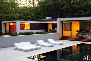 Contemporary Swimming Pool with Raised beds, exterior tile floors