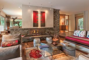 Contemporary Living Room with Hardwood floors, Standard height, French doors, can lights, Fireplace, stone fireplace