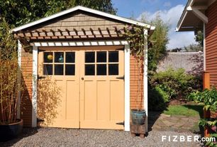 Traditional Garage with complex granite floors, French doors