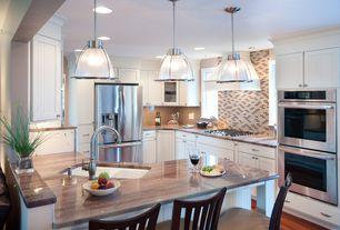 Contemporary Kitchen with can lights, Flush, Undermount sink, Kitchen peninsula, Custom hood, double wall oven, Pendant light