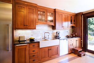 Craftsman Kitchen with Stone Tile, Limestone Tile, Marmoleum sheet flooring in shell with henna border, Inset cabinets, Flush
