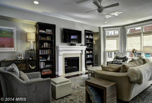 Contemporary Living Room with can lights, Standard height, Ceiling fan, Hardwood floors, double-hung window