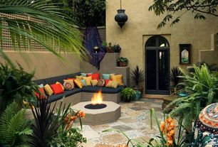 Mediterranean Patio with Raised beds, Classic stone 0.5 cu. ft. pea pebbles, Pathway, French doors, exterior stone floors
