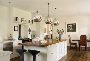 Contemporary Kitchen with Quartz counters, Dupont Corian Designer White, Flat panel cabinets, Kitchen island with seating