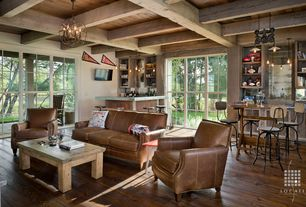 Rustic Family Room with Restoration Hardware Cast Iron Barn Door Trolley Pendant, Built-in bookshelf, Chandelier