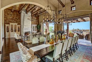Mediterranean Great Room with picture window, Fireplace, Interior stone wall, Casement, Columns, sliding glass door