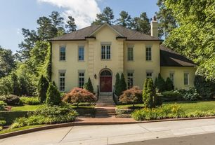 Traditional Exterior of Home with Shingle roof, Transom window, Exterior stone chimney, Stone steps, Pathway, Arched window