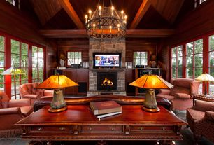 Rustic Living Room with Exposed beam, Concrete tile , Chandelier, Built-in bookshelf, stone fireplace, French doors