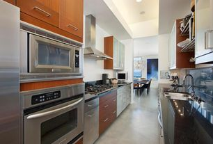 Contemporary Kitchen with Flush, Built In Refrigerator, single dishwasher, Absolute black granite, Soapstone counters, Galley