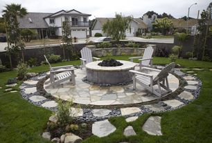 Traditional Patio with Fence, Fire pit, Pathway, exterior stone floors, Raised beds