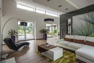 Modern Living Room with Zagato leather chaise lounge by contempo #18205, High ceiling, Drum pendant light, Stone tile wall