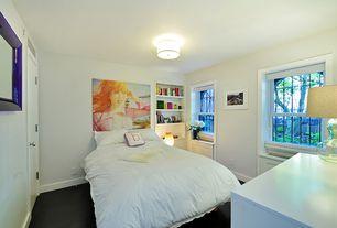 Contemporary Guest Bedroom with Hardwood floors, flush light, Built-in bookshelf