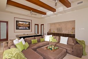Contemporary Living Room with Built-in bookshelf, Laminate floors, Tile accent wall, Glass panel door, Exposed beam