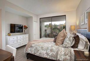 Modern Master Bedroom with specialty door, Laminate flooring, Hardwood floors, Paint, sliding glass door, Standard height
