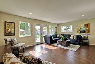Contemporary Living Room with Standard height, can lights, Hardwood floors, Casement, French doors