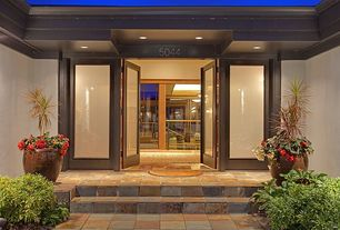 Contemporary Front Door with picture window, exterior stone floors, French doors