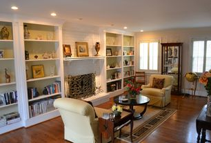 Traditional Living Room with Built-in bookshelf, can lights, Standard height, Fireplace, Hardwood floors, double-hung window