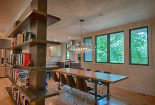 Modern Dining Room with Standard height, Hardwood floors, Casement, Built-in bookshelf, Chandelier