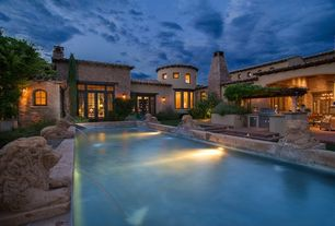 Mediterranean Swimming Pool with Transom window, Outdoor kitchen, Trellis, Lap pool, Arched window, French doors