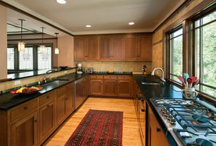 Traditional Kitchen with Pendant light, electric cooktop, full backsplash, can lights, Pental black soapstone, Paint 1