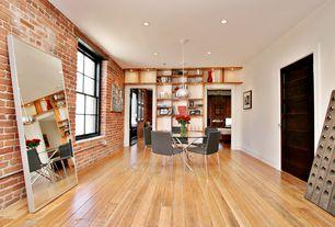 Modern Dining Room with Hardwood floors, double-hung window, Built-in bookshelf, flush light, can lights, Standard height