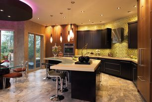 Contemporary Kitchen with Corian counters, Caserstone 2141 Blizzard Quartz, Flush, Pendant light, Ceramic Tile, Breakfast bar