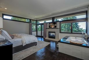 Modern Master Bedroom with stone fireplace, Barnwood, Safavieh Tibetan Tb837a Cream - Stone Area Rug, Transom window