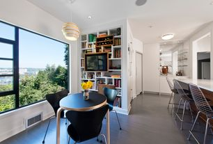 Modern Dining Room with specialty window, Standard height, can lights, Built-in bookshelf, Pendant light, Laminate floors